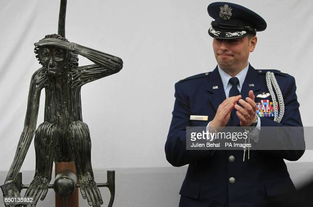 US Air Force LieutenantColonel Sean Cosden of the US Defence Attache in the garden of O'Donovan's Hotel applauds at the unveiling of a statue of...