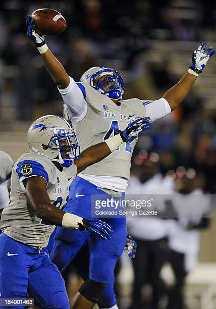 Air Force linebacker Kristov George right celebrates after making an interception in the second quarter against San Diego State at Falcon Stadium in...