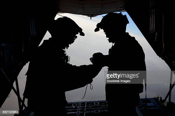 U.S. Air Force loadmasters fold the American flag aboard an HC-130 Hercules.