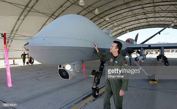 S Air Force Maj Casey Tidgewell inspects an MQ9 Reaper as he performs a preflight check August 8 2007 at Creech Air Force Base in Indian Springs...