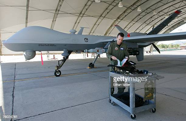 S Air Force Maj Casey Tidgewell prepares an MQ9 Reaper for a training flight August 8 2007 at Creech Air Force Base in Indian Springs Nevada The...