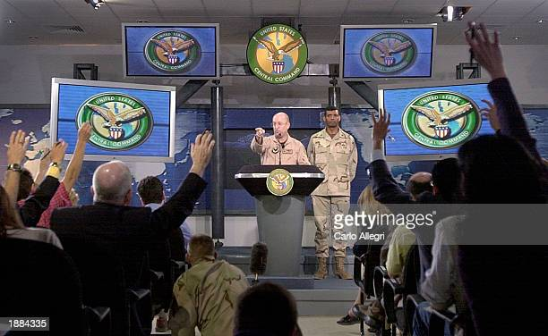 Air Force Major General Victor Renuart takes a question from a journalist as U.S. General Vincent Brooks Stands nearby at the Coalition Media Center...