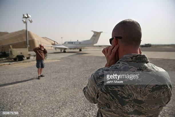S Air Force major plugs his ears as a US Army C12 Huron transport arrives to an air base in the Persian Gulf region on January 6 2016 The US military...