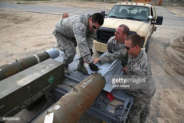 S Air Force munitions team mounts the fin onto a 500 pound bomb to be loaded onto an unmanned aerial vehicle for airstrikes on ISIL targets on...