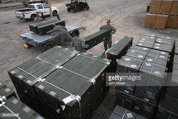 S Air Force munitions team transports Hellfire missles to be loaded onto Predator drones on January 8 2016 at a base in the Persian Gulf Region The...