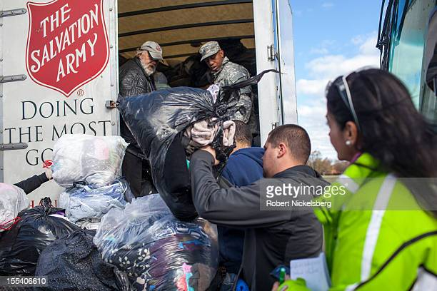 S Air Force National Guard helps the Salvation Army load a truck with donated clothes for distribution November 3 2012 in Midland Beach after...