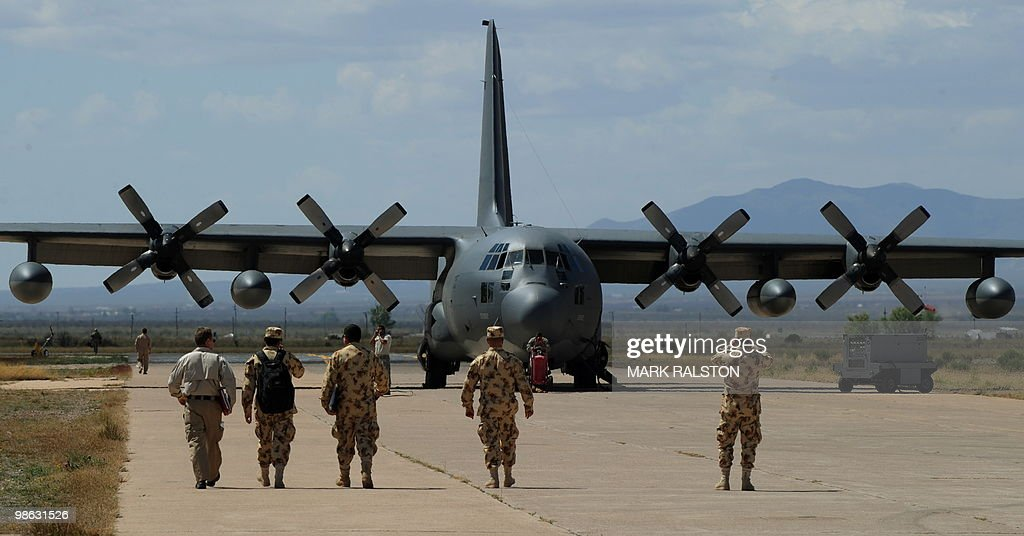 Air Force observors from Colombia walk towards a C-130 plane before a rescue operation during Exercise Angel Thunder, near the town of Bisbee in Arizona's Sonoran Desert on April 21, 2010. Exercise Angel Thunder simulates personnel recovery missions behind enemy lines and is the largest Department of Defense personnel recovery exercise to date. International observors from from Australia, Brazil, Canada, Chile, Colombia, Denmark, France, Germany, Netherlands, and United Kingdom took part in the event. AFP PHOTO/Mark RALSTON