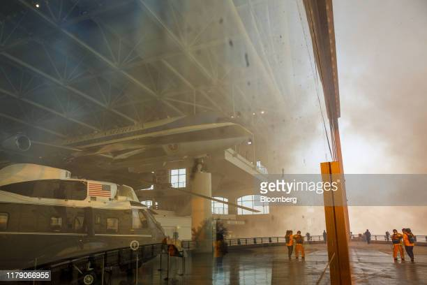 Air Force One and Marine One stand on display in the Ronald Reagan Presidential Library as smoke rises outside during the Easy Fire in Simi Valley...