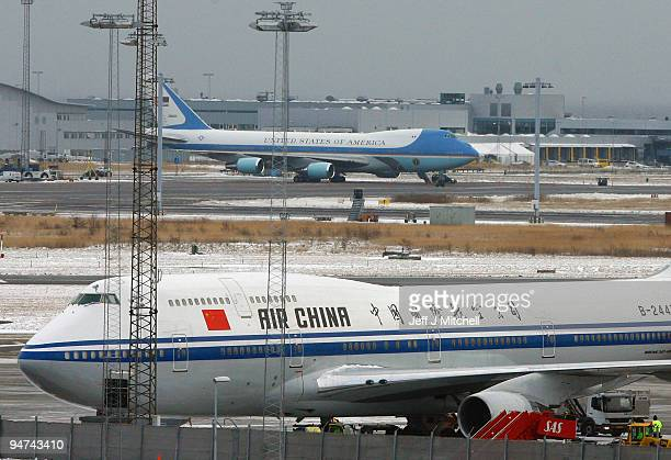 Air Force One and the plane of Chinese Prime Minister Wen Jiabao wait on the tarmac along with other aircraft waiting to return World leaders home...
