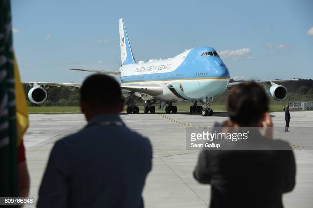 Air Force One carrying US President Donald Trump and First Lady Melania Trump arrives at Hamburg Airport for the Hamburg G20 economic summit on July...