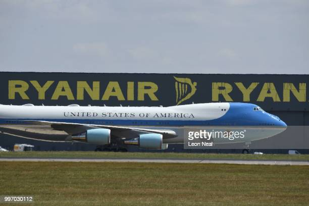 Air Force One carrying US President Donald Trump and First Lady Melania Trump's passes Ryan Air signage as it comes in to land at Stansted Airport on...