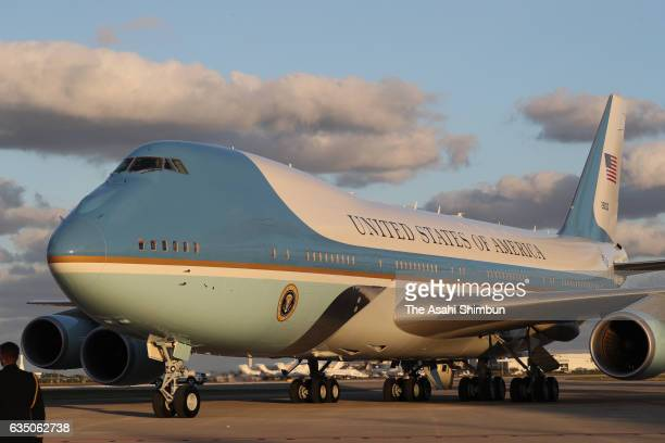 Air Force One carrying US President Donald Trump and Japanese Prime Minister Shinzo Abe arrives at Palm Beach International Airport on February 10...