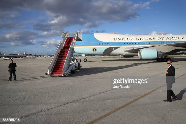 Air Force One carrying US President Donald Trump arrives at the Palm Beach International Airport so the President can spend Easter weekend at...