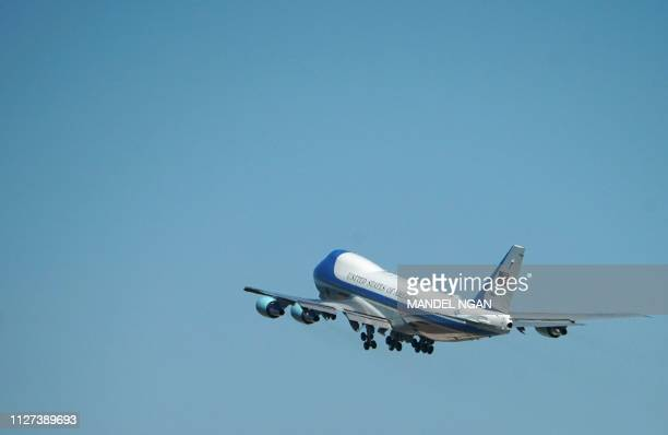 TOPSHOT Air Force One carrying US President Donald Trump takes off from Joint Base Andrews in Maryland February 25 as he travels to Hanoi Vietnam for...