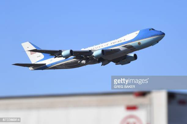 Air Force One carrying US President Donald Trump takes off from Beijing airport on its way to Danang in Vietnam for the Asia Pacific Economic...