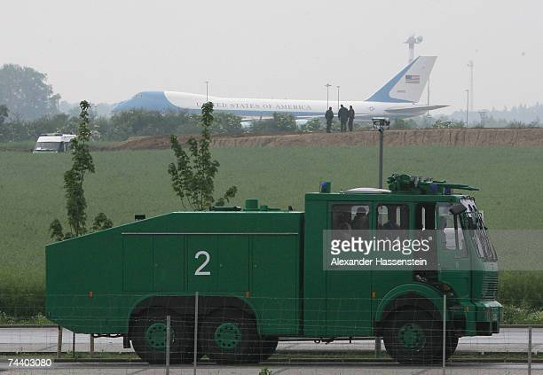 Air Force One carrying US President George W Bush lands at RostockLaage airport as German police in a water cannon truck stand nearby June 5 2007 at...