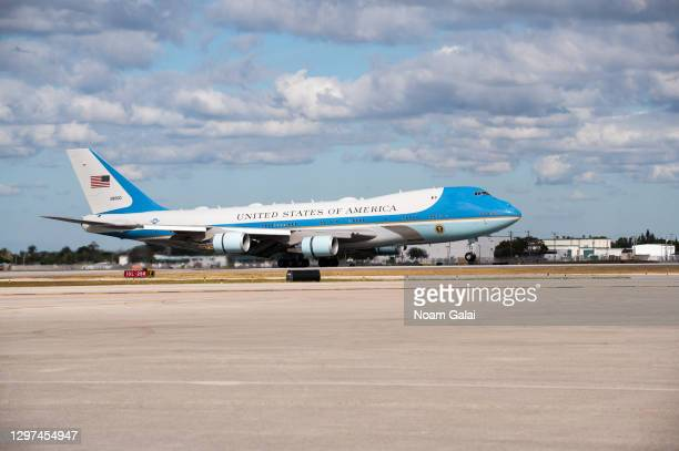 Air Force One lands carrying outgoing U.S. President Donald Trump and First Lady Melania Trump at the Palm Beach International Airport on the way to...