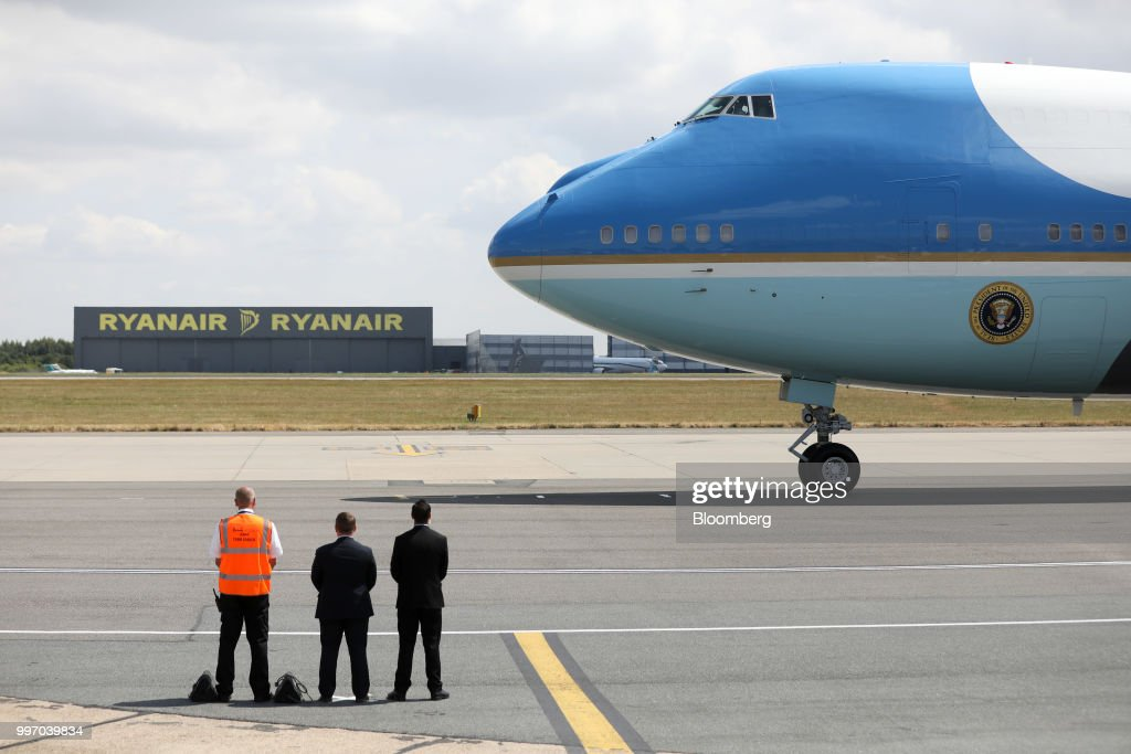 Air Force One taxis past a hanger for Ryanair Holdings Plc at London Stansted Airport in Stansted, U.K., on Thursday, July 12, 2018. U.S. President Donald Trump will avoid London as much as possible as he's whisked off on a tour of prime British real estate to keep him away from protesters during his U.K. visit. Photographer: Chris Ratcliffe/Bloomberg via Getty Images