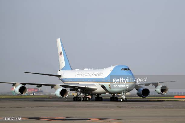 Air Force One with US President Donald Trump and First Lady Melania Trump on board taxis on the tarmac after arriving at Haneda Airport in Tokyo...