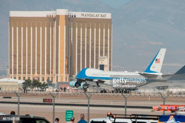 Air Force One with US President Donald Trump and First Lady Melania Trump land at McCarran International Airport in Las Vegas on October 4 with the...