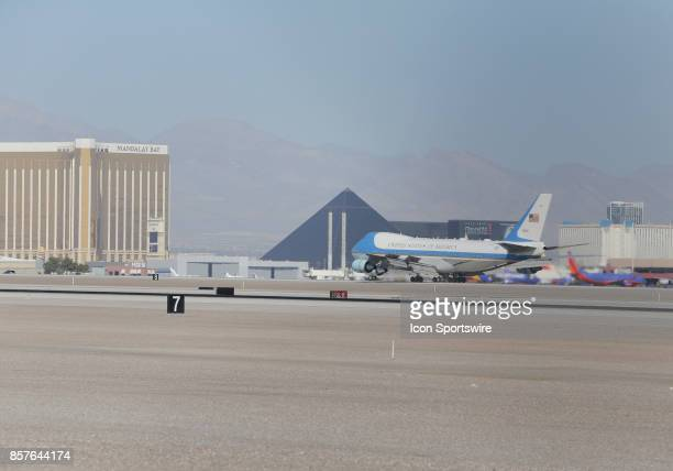 Air Force One with US President Donald Trump and First Lady Melania Trump land at McCarran International Airport in Las Vegas Nevada October 4 with...