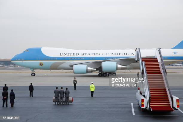 Air Force One with US President Donald Trump and First Lady Melania Trump on board arrives at Beijing airport on November 8 2017 US President Donald...