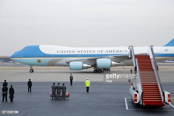 Air Force One with US President Donald Trump and first lady Melania on board arrives at Beijing airport on November 8 2017 in Beijing China Trump is...