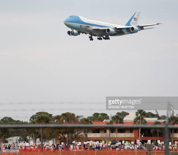 Air Force One with US President Donald Trump on board arrives for a rally at the Orlando Melbourne International Airport above dozens of...
