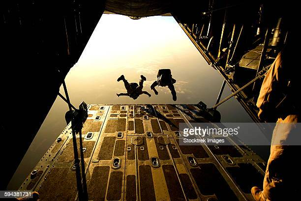 U.S. Air Force pararescuemen jump from an HC-130 aircraft off the coast of Djibouti.