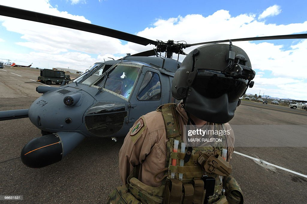 Air Force pilot Flight Lt. Aaron Walton stands in front of his HH-60 Pave Hawk before a rescue operation during Exercise Angel Thunder, near the town of Bisbee in Arizona's Sonoran Desert on April 21, 2010. Exercise Angel Thunder simulates personnel recovery missions behind enemy lines and is the largest Department of Defense personnel recovery exercise to date. International observors from from Australia, Brazil, Canada, Chile, Colombia, Denmark, France, Germany, Netherlands, and United Kingdom took part in the event. AFP PHOTO/Mark RALSTON