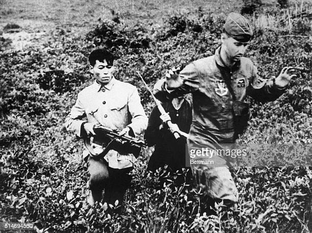 US Air Force pilot Lt Hayden Lockhardt is captured by a North Vietnamese militiaman after he was forced to eject from his disabled jet over North...