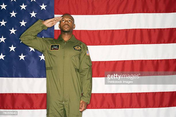 US Air Force pilot saluting and American flag