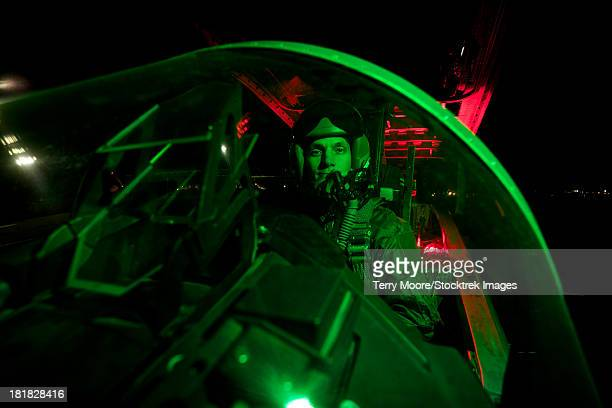 A U.S. Air Force pilot sitting inside the cockpit of a McDonnell Douglas F-15C aircraft.