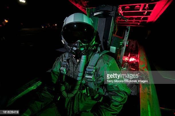 A U.S. Air Force pilot sitting inside the cockpit of a McDonnell Douglas F-15C aircraft.