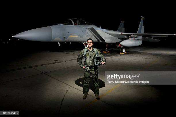 A U.S. Air Force pilot stands in front of a McDonnell Douglas F-15C aircraft.