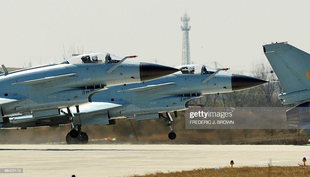 Air Force pilots take off in Chinese J-10 fighter jets for a display