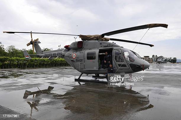 Air force pilots waiting for the rains to stop at the Jolly grant airport on Wednesday so that they could fly their relief material loaded...