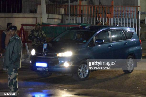 Air Force Police car allegedly transporting Indian Air Force Wing Commander Abhinandan Varthaman drives out of the Integrated Check Post near the...