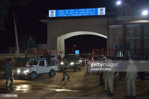 Air Force Police cars leave the Integrated Check Post after Indian Air Force Wing Commander Abhinandan Varthaman was freed to return to India near...