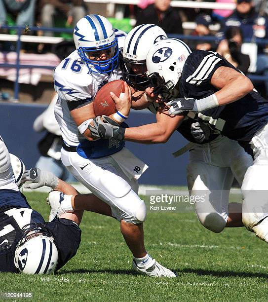 Air Force quarterback Adam Fitch is tackled hard by BYU defenders at LaVelle Edwards Field in Provo Utah Saturday October 29 2005