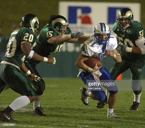 Air Force quarterback Chance Harridge gets tackled by Colorado State defenders Jeff Flora Drew Wood and Adam Haywood during the fourth quarter at...