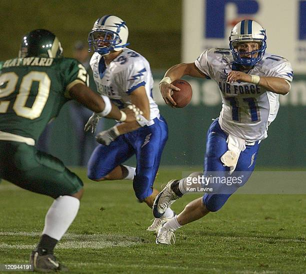Air Force quarterback Chance Harridge runs for a gain against Colorado states Adam Haywood 20 during the fourth quarter at Sonny Lubick Field in Ft...