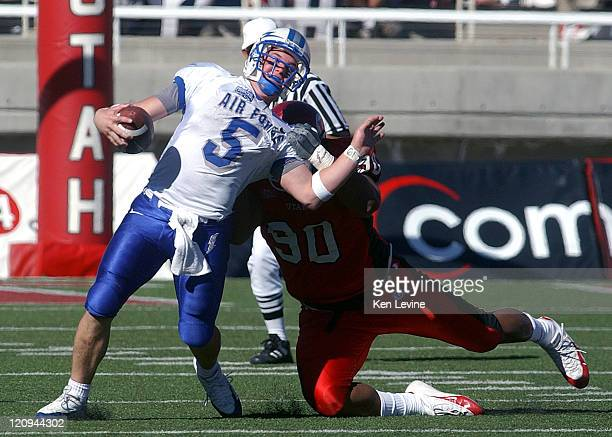 Air Force quarterback Shaun Carney is sacked by Utahs' Sione Pouha for a 4 yard loss during the fourth quarter at Rice-Eccles Stadium in Salt Lake...