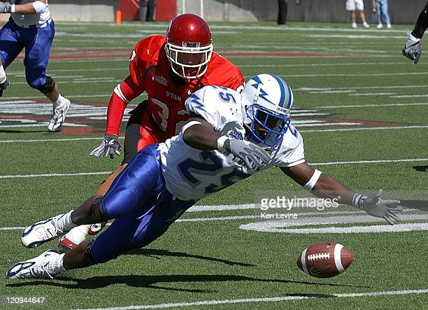 Air Force receiver Anthony Butler dives upon a loose ball that was fumbled by quarterback Shaun Carney during the first quarter as Utah safety Eric...
