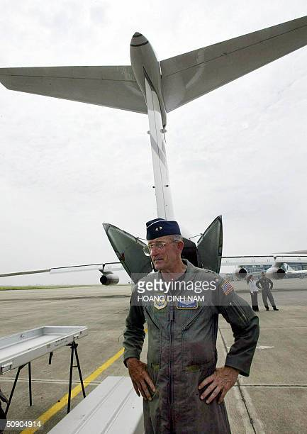 Air Force Reserve Major General Edward J Mechenbier stands next to a casket he will bring home with the remains of MIAs on his final mission aboard a...