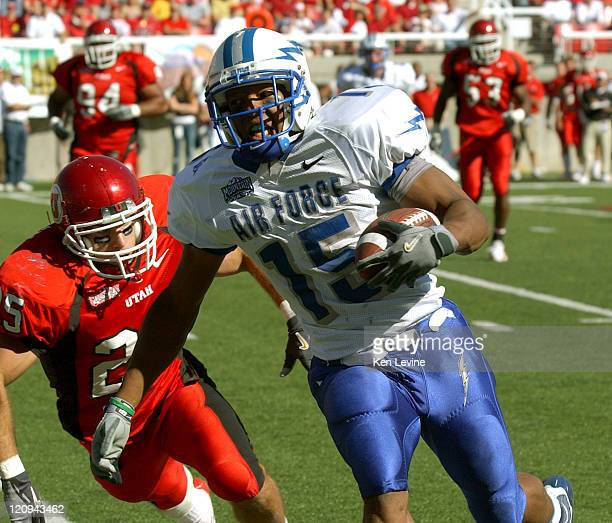 Air Force running back Darnell Stephens runs past Utahs' Morgan Scalley to the 6 yard line during the third quarter at RiceEccles Stadium in Salt...