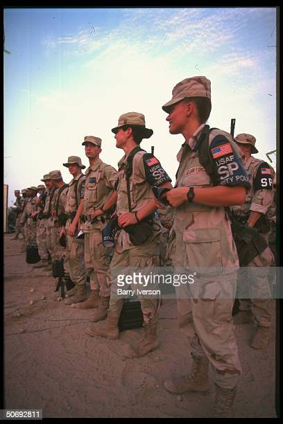 US Air Force Security Police women soldiers poised w male comradesatarms during routine daily briefing responsible for security at US air base