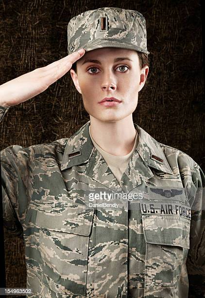 us air force series: american airwoman against dark brown background - saluting stock pictures, royalty-free photos & images