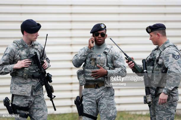 A US Air Force soldier center speaks on the phone during the Max Thunder Air Exercise a bilateral training exercise between the South Korean and US...