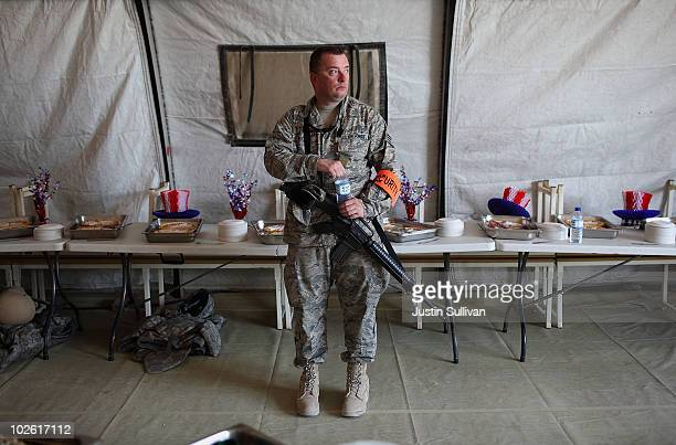 S Air Force Staff Sgt Timothy Secora guards a table with desserts during an Independence Day BBQ for troops at Kandahar Airfield July 4 2010 in...